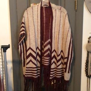 Maroon and cream print sweater with fringe bottom